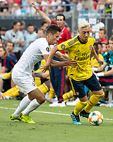 CHARLOTTE, NC - JULY 20: Mesut Ozil #10 dribbles the ball against David Hancko #16 during a game between ACF Fiorentina and Arsenal at Bank of America Stadium on July 20, 2019 in Charlotte, North Carolina.