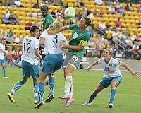 Abby Wambach #20 of Abby's XI heads over Allison Falk #3 of Marta's XI during the WPS All-Star game at KSU Stadium in Kennesaw, Georgia on June 30 2010. Marta XI won 5-2.