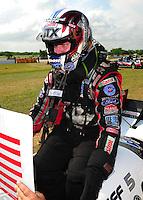 Apr. 29, 2012; Baytown, TX, USA: NHRA funny car driver Mike Neff celebrates after winning the Spring Nationals at Royal Purple Raceway. Mandatory Credit: Mark J. Rebilas-