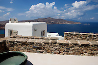white cycladic house with sea view