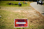 May 6, 2008. Bynum, NC.. With the close North Carolina primary battle between Senators Hillary Clinton and Barack Obama, voters hit the polls to try and bring closure to this highly contested state and divide the delegates between the 2 candidates..Campaign workers sit outside a polling station to try and persuade voters for their chosen candidate.