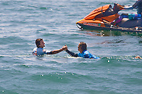 South African Jordy Smith (b) congratulates American Brett Simpson (w) after being defeated by Simpson during final day of the 2010 US Open of Surfing in Huntington Beach, California on August 6, 2010.