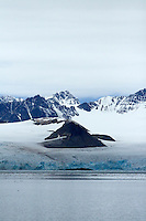 Mountain ringed by Glacier at end of Krossfjord Ny Alesund Spitsbergen  Barents sea North East Atlantic ocean