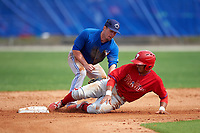 Philadelphia Phillies Rodolfo Duran (10) slides safely into second base under the tag of Aaron Attaway (59) during a minor league Spring Training game against the Toronto Blue Jays on March 26, 2016 at Englebert Complex in Dunedin, Florida.  (Mike Janes/Four Seam Images)