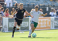 Leigh Ann Robinson (7) chases Stephanie Logterman (3) for the ball. St. Louis Athletica defeated FC Gold Pride 1-0 at Buck Shaw Stadium in Santa Clara, California on July 5, 2009.