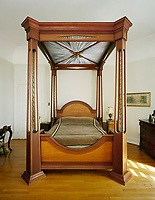 High Victorian ceilings help accommodate this dramatic four-poster bed in New Orleans