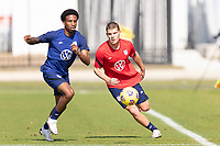 BRADENTON, FL - JANUARY 23: Kyle Duncan, Chris Mueller battle for a ball during a training session at IMG Academy on January 23, 2021 in Bradenton, Florida.