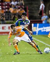 Seattle Sounders defender Leo Gonzalez (19) pushes Houston Dynamo midfielder Brian Mullan (9).  Houston Dynamo tied Seattle Sounders 1-1 on August 23, 2009 at Robertson Stadium in Houston, TX.