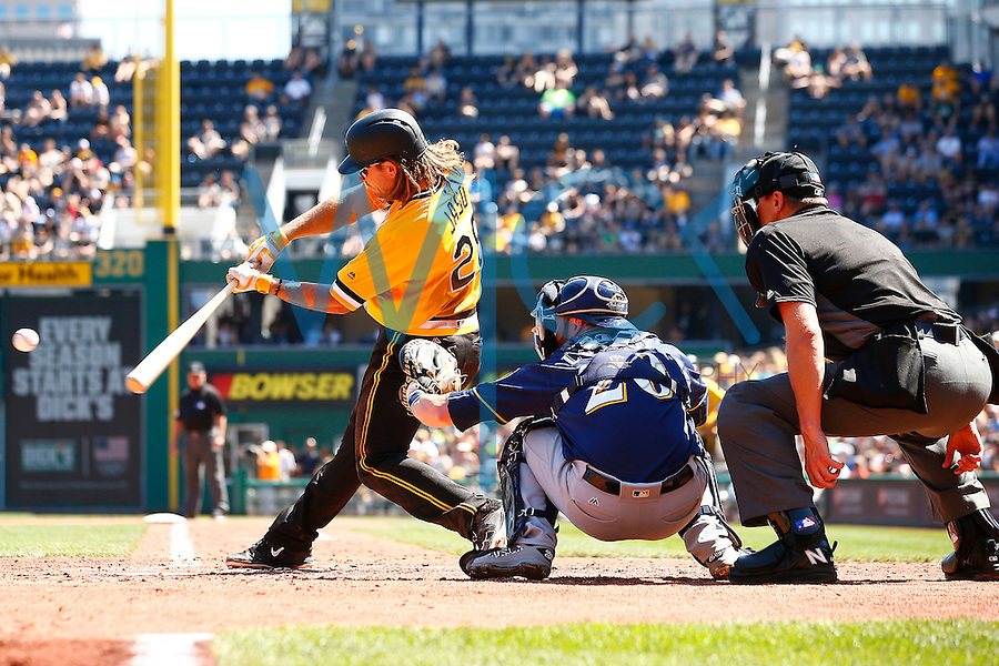 John Jaso #28 of the Pittsburgh Pirates hits an RBI single in the third inning against the Milwaukee Brewers during the game at PNC Park in Pittsburgh, Pennsylvania on April 17, 2016. (Photo by Jared Wickerham / DKPS)