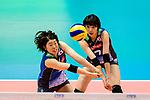 Mami Uchiseto of Japan (L) passes the ball during the match between China and Japan on May 30, 2018 in Hong Kong, Hong Kong. (Photo by Power Sport Images/Getty Images)