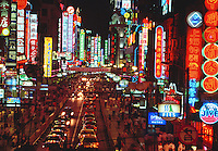 Overview of Nanjing Road and colorful neon signage at night. Shanghai, China.
