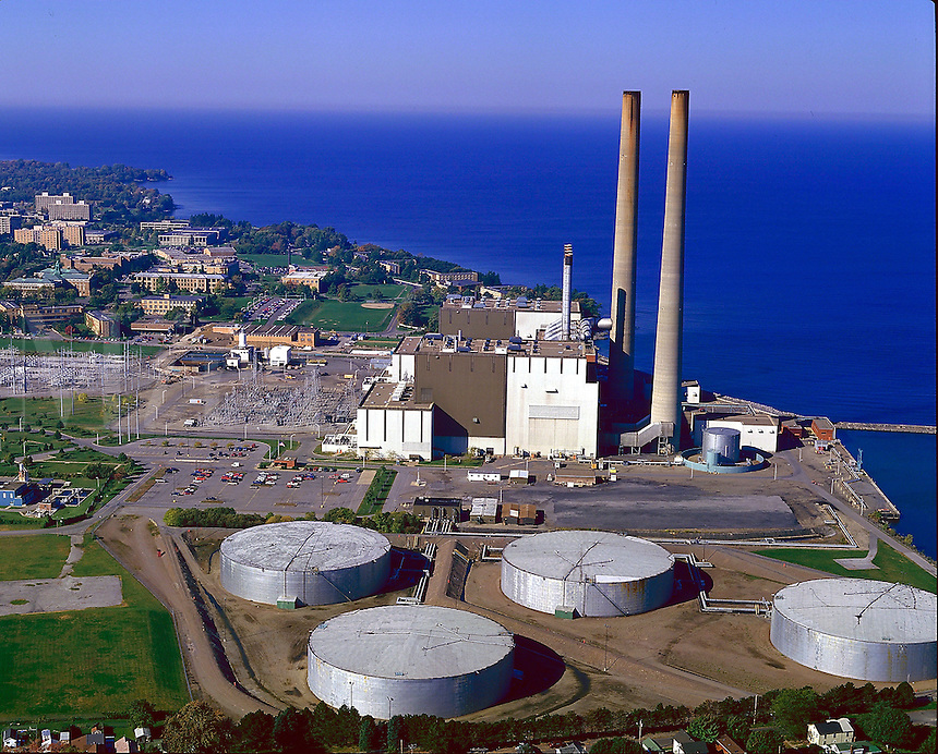 Oil burning electric power plant on the shore of Lake Ontario, electricity, energy, 08-6500. Oswego New York United States.