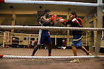 INDIA (West Bengal - Calcutta)July 2007,Shanno Babe during practice at Sports Authority of India Complex (East Zone) in Kolkata. Shakila and Shanno are twins from a poor muslim family of Iqbalpur, Kolkata. . Inspite of their late father's unwillingness to send his daughters to take up  boxing her mother Banno Begum inspired them to take up boxing at the age of 3. Their father was more concerned about the social stigma they have in their community regarding women coming into sports or doing anything which may show disrespect to the religious emotions of his community. Shakila now has been recognised as one of the best young woman boxers of the country after she won the  international championship at Turkey in the junior category. Shanno is also been called for the National camp this year. Presently Shakila and shanno has become the role model in the Iqbalpur area  and parents from muslim community of Iqbalpur have started showing interst in boxing. Iqbalpur is a poor muslim dominated area mostly covered with shanty town with all odds which comes along with poverty and lack of education. - Arindam Mukherjee