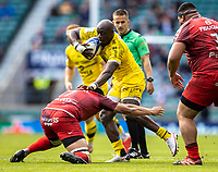 22nd May 2021; Twickenham, London, England; European Rugby Champions Cup Final, La Rochelle versus Toulouse; Raymond Rhule of La Rochelle is tackled by Francois Cros of Toulouse