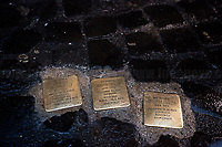 """The Stolpersteine (Pietre d'Inciampo - Stumbling Stones, 3.). <br /> <br /> Rome, 27/01/2020. Today is the International Holocaust Day, also called Holocaust Memorial Day in UK & Italy. A day designated by the UN General Assembly resolution 60/7 on 1 November 2005 to remember the victims of the Holocaust: 6 million Jews, 2 million Gypsies (Roma & Sinti), 15,000 homosexual people, and millions of others killed by the Nazi regime and its collaborators. The 27th of January (1945) marks the day of the liberation by the Soviet Union Army of the largest death camp, Auschwitz-Birkenau (75th Anniversary). To coincide with the Holocaust Memorial Day the Theater and Kunst Diletta Benincasa Foundation - Berlin (1.), supported by the Biblioteca di Storia Moderna e Contemporanea (Palazzo Mattei), promoted the event called """"Displaced"""" curated by Patrizia Bisci (2.). From the organizers press release: «The project unfolds in a path inside the old ghetto of Rome and materializes in installations, works and performances. […] the world of experiences and experimentation of the artists will thus become the ideal basis for understanding collective history. In fact, """"Displaced persons"""", a historical name with both positive and negative value, is the theme in memory of the history of Europe, when at the end of the Second World War the extermination camps were freed by the armies of the allies. Eleven million prisoners, among whom only a few thousand surviving Jews, no longer knew where to return. The houses, their lives were destroyed, occupied by others. Where to return? […]».<br /> <br /> Footnotes & Links:<br /> 1. http://bit.do/fqRC2<br /> 2. http://bit.do/fqRCF<br /> 3. http://bit.do/fqRXC<br /> Nel Giorno Della Memoria (Source, Treccani.it) http://bit.do/fqRG5<br /> 27.01.19 Holocaust Memorial Day 2019 - Never Forget - Witnesses Of Witnesses http://bit.do/fqRXh"""
