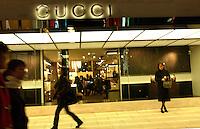 People shop at the French designer Gucci fashion designer goods in Shinjuku, Tokyo. Despite the recession the big designers remain popular in Tokyo.. ...