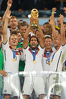 Sami Khedira of Germany celebrates winning the FIFA World Cup trophy with team mates
