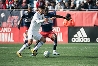 FOXBOROUGH, MA - MARCH 7: Mauricio Pineda #22 of Chicago Fire and Wilfried Zahibo #23 of New England Revolution battle for the ball during a game between Chicago Fire and New England Revolution at Gillette Stadium on March 7, 2020 in Foxborough, Massachusetts.