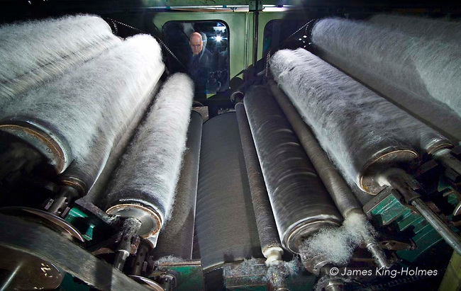 A carding machine processing organic sheep's wool in a UK textile mill specialising in the processing of organic wool. Photographed at the Natural Fibre Company Ltd, Launceston, UK.