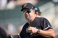 Kannapolis Intimidators pitching coach Brian Drahman (45) uses a walkie-talkie to communicate with the bullpen during the game against the Greensboro Grasshoppers at Intimidators Stadium on July 17, 2016 in Greensboro, North Carolina.  The Intimidators defeated the Grasshoppers 3-2 in game one of a double-header.  (Brian Westerholt/Four Seam Images)
