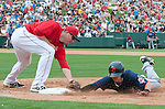 Los Angeles Angels Mark Trumbo puts a tag on Cleveland Indians Jason Kipnis.