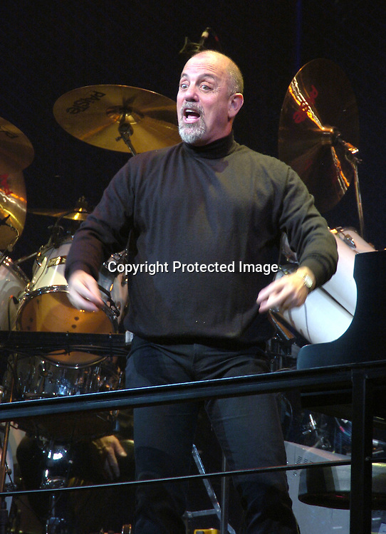 """Billy Joel singing..at the Celebration of the beginning of the Third Year of """"Movin' Out"""" on Broadway on October 24, 2004 at the Richard Rogers Theatre. Photo by Robin Platzer, Twin Images"""