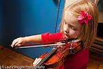 Educaton elementary Kindergarten student playing the violin