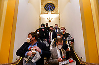 People evacuate from the House Camber as protesters try to break into the House Chamber at the U.S. Capitol on Wednesday, Jan. 6, 2021, in Washington. (AP Photo/Andrew Harnik)