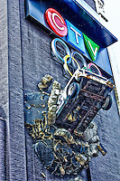 Looking up at the CP24 news vehicle breaking through the wall at the CTV studios in downtown Toronto