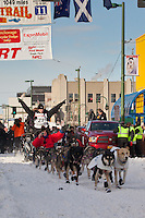 Musher Dallas Seavey and Iditarider Terry Walker.leave the 2011 Iditarod ceremonial start line in downtown Anchorage, Alaska