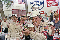 Davey Allison celebrates in victory lane after winning the Pepsi 400 at Daytona International Speedway in Daytona Beach, FL on July 1, 1989. (Photo by Brian Cleary/www.bcpix.com)