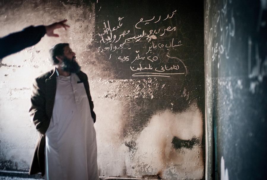 Graffiti is pointed out on the walls at a special police headquarters in Tobruk, LIbya.