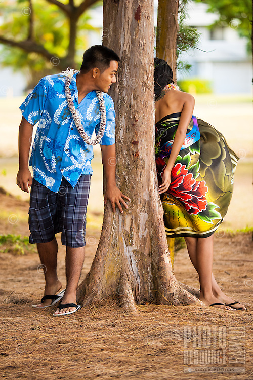 A young, engaged local couple enjoying each other's presence at Kailua Beach Park, Windward O'ahu.