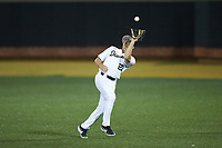 Wake Forest Demon Deacons second baseman Chase Mascolo (28) catches a fly ball in shallow right field during the game against the Sacred Heart Pioneers at David F. Couch Ballpark on February 15, 2019 in  Winston-Salem, North Carolina.  The Demon Deacons defeated the Pioneers 14-1.  (Brian Westerholt/Four Seam Images)