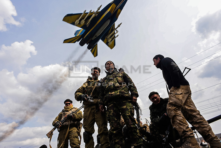 A jet fighter Mig 24 performs a fly-by as  Ukrainian forces are being blocked by local citizens near Kramatorsk city during the anti-terrorist operation. Kramatorsk, Ukraine. April 8, 2014