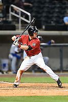 Birmingham Barons third baseman Chris Curley (4) at bat during a game against the Tennessee Smokies on April 22, 2014 at Regions Field in Birmingham, Alabama.  Birmingham defeated Tennessee 14-3.  (Mike Janes/Four Seam Images)