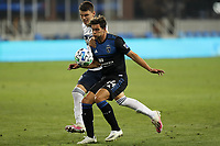SAN JOSE, CA - OCTOBER 07: Cade Cowell #44 of the San Jose Earthquakes is marked by Ranko Veselinovic during a game between Vancouver Whitecaps and San Jose Earthquakes at Earthquakes Stadium on October 07, 2020 in San Jose, California.