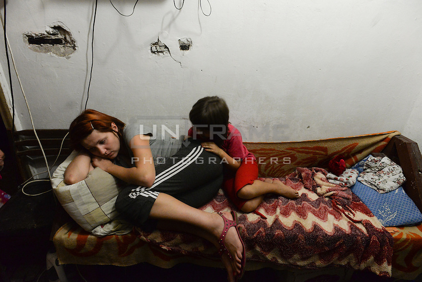 Mother and daughter live in a bomb shelter since two months, Donetsk, Eastern Ukraine.