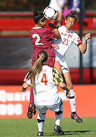 COLLEGE PARK, MD - OCTOBER 21, 2012:  Alexis Prior-Brown (23) of the University of Maryland goes for a high ball with Ines Jaurena (2) of Florida State during an ACC women's match at Ludwig Field in College Park, MD. on October 21. Florida won 1-0.