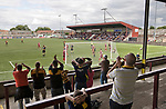 Stenhousemuir 0 Alloa Athletic 1, 21/08/2010. Stadium, Scottish Second Division. Supporters of Alloa Athletic football club (in yellow) cheering on their team at Ochilview stadium, Larbert, during their team's Irn Bru Scottish League second division match against Stenhousemuir. Alloa won the match by one goal to nil against their local rivals in a match watched by 619 spectators. Photo by Colin McPherson.