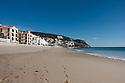 View along the beach (Praia do Ouro), towards the fort (Fortaleza de Santiago), Sesimbra, Portugal