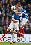 Lee McCulloch and Ross Perry combine to squeeze out Queens Captain Tony Quinn