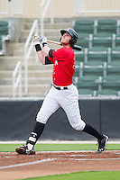 Danny Hayes (32) of the Kannapolis Intimidators follows through on his swing against the Greenville Drive at CMC-Northeast Stadium on April 6, 2014 in Kannapolis, North Carolina.  The Intimidators defeated the Drive 8-5.  (Brian Westerholt/Four Seam Images)