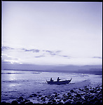 On Bali's west coast fisherman prepare to come ashore in the village of Medewi at sunset.