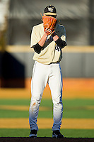 Starting pitcher Brian Holmes #45 of the Wake Forest Demon Deacons looks to his catcher for the sign against the Georgetown Hoyas at Wake Forest Baseball Park on February 26, 2012 in Winston-Salem, North Carolina.  The Demon Deacons defeated the Hoyas 5-2.  (Brian Westerholt / Four Seam Images)