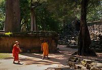 """Buddhist Monks visiting Preah Khan in the Angkor Wat temple area Preah Khan was built on the site of Jayavarman VII's victory over the invading Chams in 1191. Unusually the modern name, meaning """"holy sword"""", is derived from the meaning of the original—Nagara Jayasri (holy city of victory). The site may previously have been occupied by the royal palaces of Yasovarman II and Tribhuvanadityavarman."""