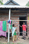 28 MAY, 2014, Gazipur District, Dhaka, Bangladesh.  Child marriage is an ongoing issue in Bangladesh where nearly two thirds of women are married before age 18.  Marriage before the age of 13 is common and two percent are married before age 11. <br /> <br /> <br /> Parul Akter (Woman matchmaker)<br /> <br /> Abdul Rahmin ( Pan teeth matchmaker)<br /> <br /> Shirazuddin and wife Firoza Begum (Kazi)<br /> <br /> Sumiya( 16) and husband Noorlim (20) and baby Samir (10 months)<br /> <br /> <br /> Picture by Graham Crouch/The Australian Magazine