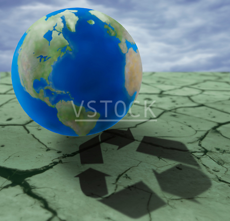 Earth on cracked ground with recycling sign, digital composite