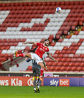 21st November 2020, Oakwell Stadium, Barnsley, Yorkshire, England; English Football League Championship Football, Barnsley FC versus Nottingham Forest; Alex Mowatt of Barnsley  goes up for a header