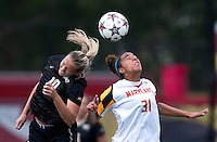 Erika Joab (31) of Maryland goes up for a header against Kim Marshall (10) of Wake Forest during the game at Ludwig Field in College Park, MD.  Maryland defeated Wake Forest, 1-0.